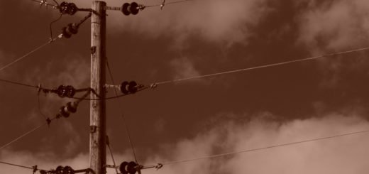 Sepia toned image showing powerlines/ phone lines, on wooden pole, high in the sky , holyoke, massachusetts